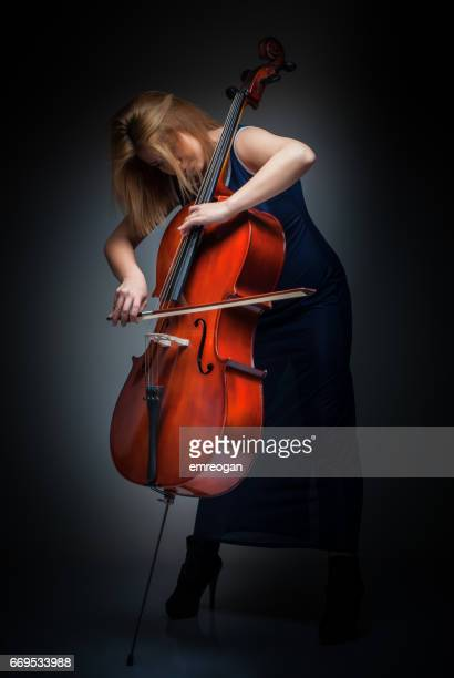 female cellist playing cello - cello stock pictures, royalty-free photos & images