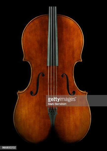 female cello backside - string instrument stock photos and pictures