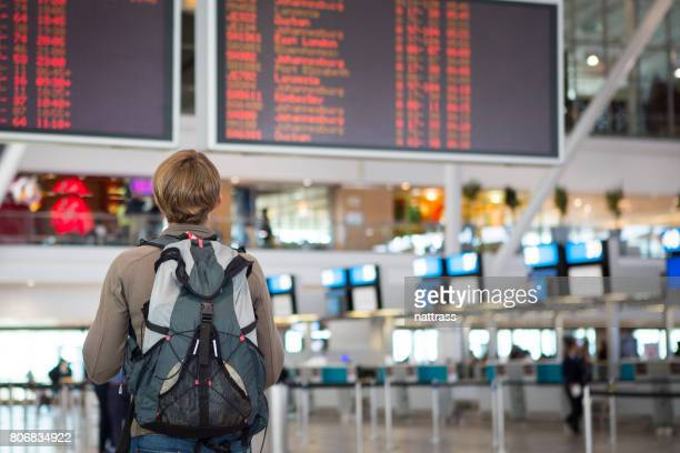 Female checking airline schedule