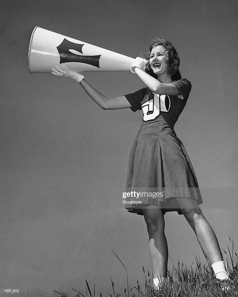 Female cheerleader using megaphone : Stock Photo