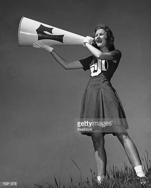 female cheerleader using megaphone - cheerleaders stock photos and pictures