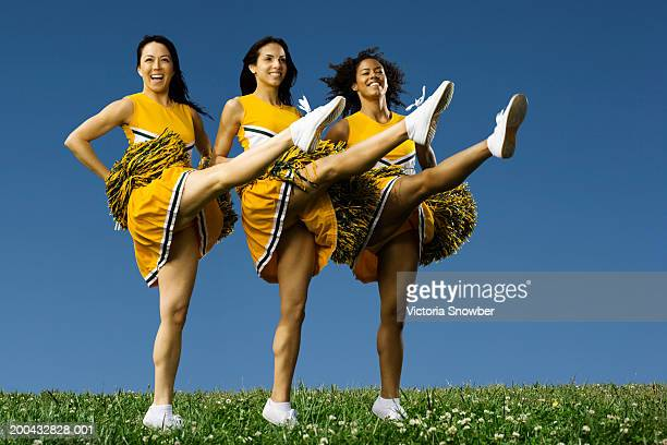 female cheerleaders doing high kicks - asian cheerleaders stock photos and pictures