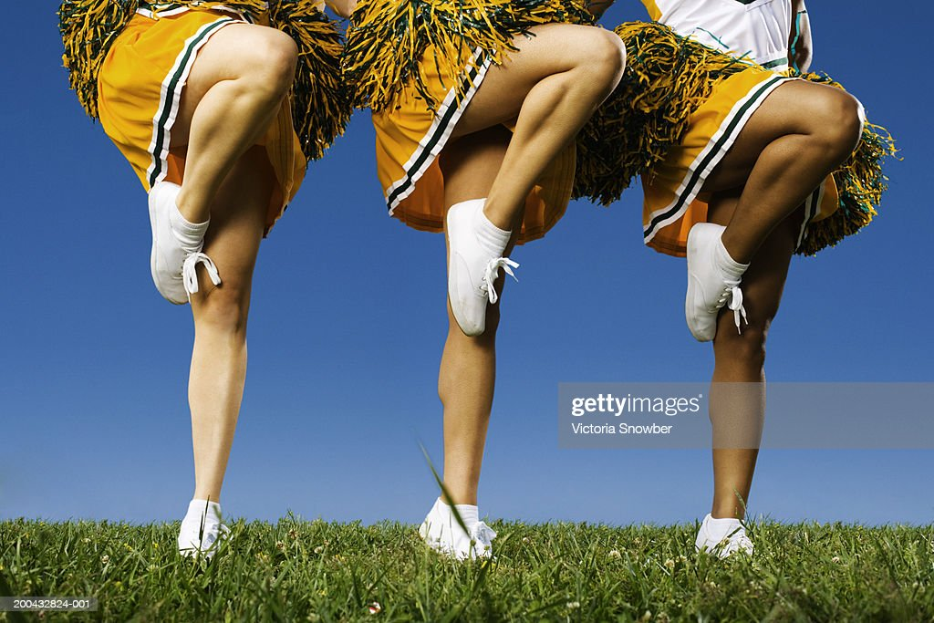 Female cheerleader's legs (low section) : Stock Photo