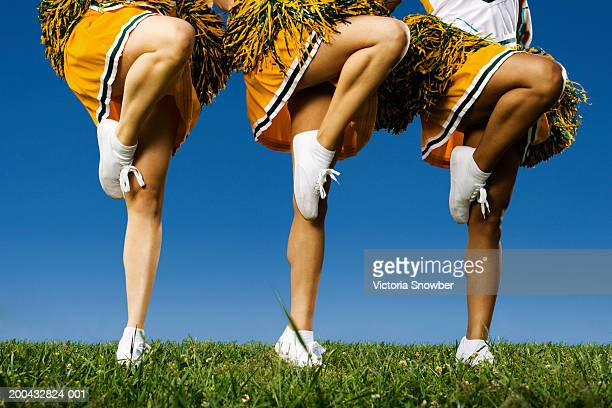 female cheerleader's legs (low section) - cheerleader foto e immagini stock