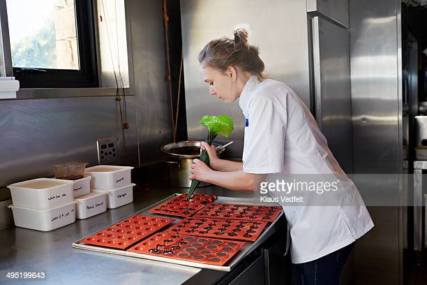 Female chef preparing chocolate at restaurant