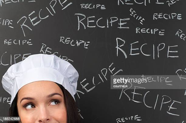 Female chef thinking in front of recipe words
