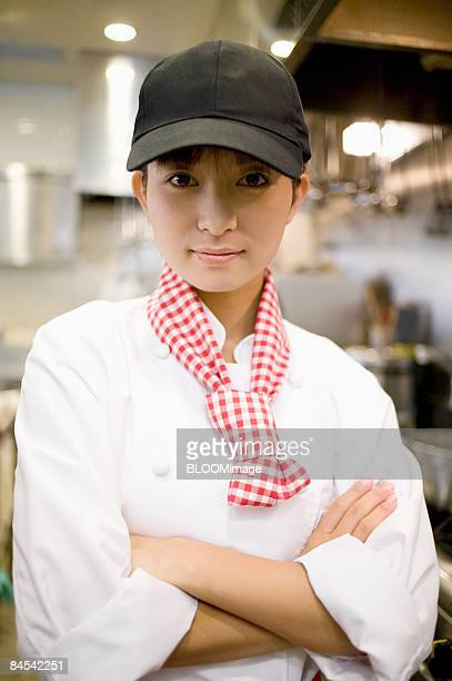 Female chef with arms folded, portrait