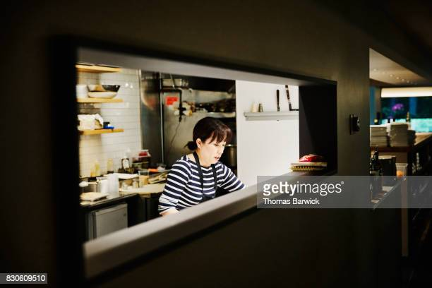 Female chef working in restaurant kitchen