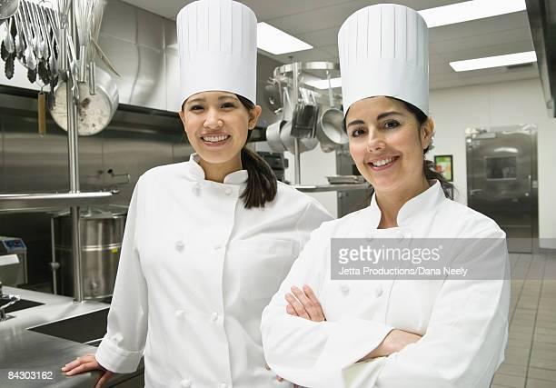 Female chefs posing in kitchen