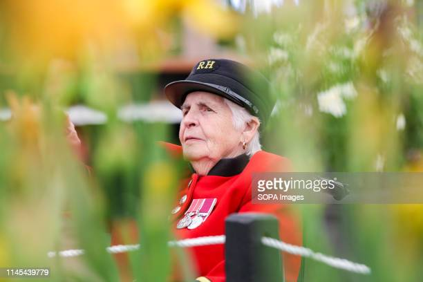 Female Chelsea Pensioner seen during the Chelsea Flower Show. The Royal Horticultural Society Chelsea Flower Show is an annual garden show over five...