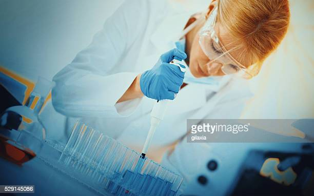 Female chemist working in laboratory.