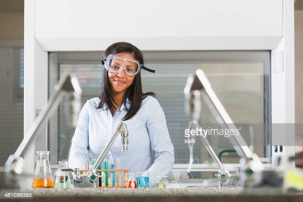 Female chemistry student doing science experiment in lab