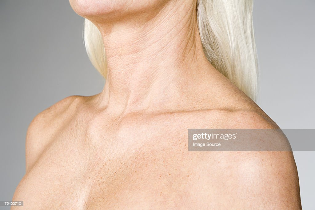 Female chest and shoulders : Stock Photo