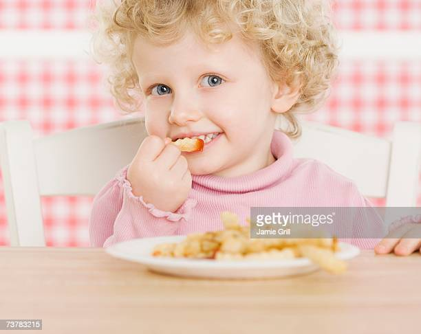 Female child eating French fries