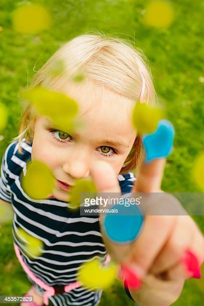 Female child with colors and finger paint