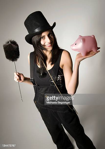 Female chimney sweep with small pig, lucky charms