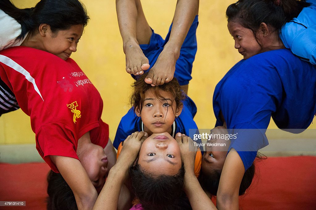 Female circus students practice for a performance on July 1, 2015 at Phare Ponleu Salpak in Battambang, Cambodia. Phare Ponleu Salpak is an organization providing free education and artistic training to Cambodian children. Students in the organization's circus program often go on to careers performing both internationally and domestically at venues like Phare - The Cambodian Circus in Siem Reap.