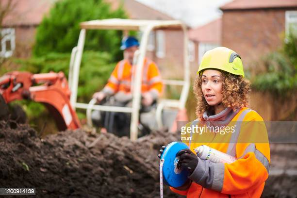 female civil engineer - driving stock pictures, royalty-free photos & images