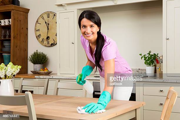 Female Cleaning the Kitchen