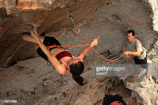 Female climber clipping a quickdraw