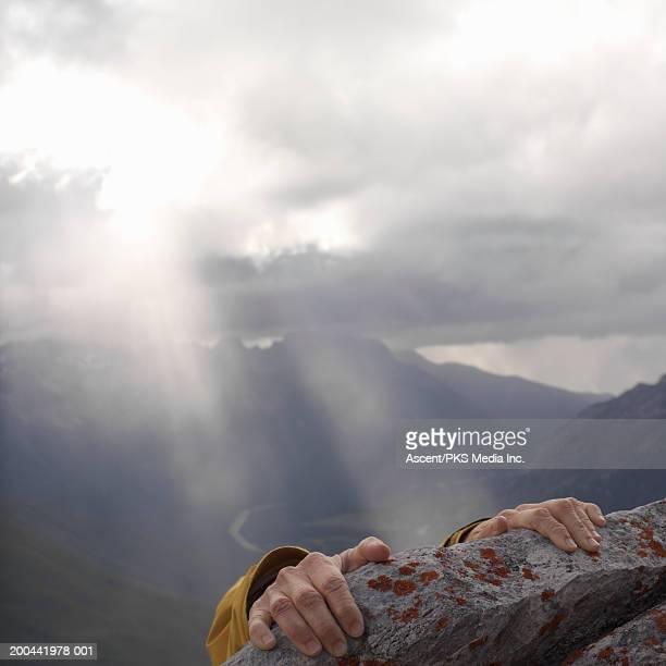 female climber gripping slab of lichened limestone, close-up, sunset - 接近する 女性 ストックフォトと画像