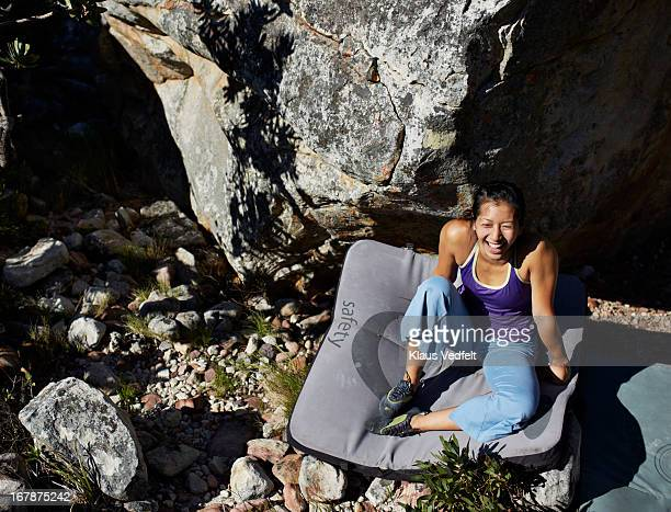 Female climber hanging out on safety mat
