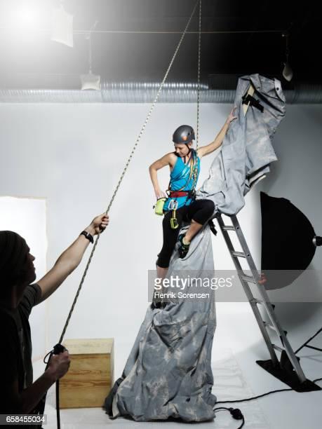 Female climber in a studio