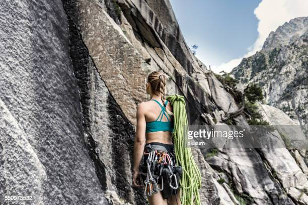 Female climber looking up at the mountain