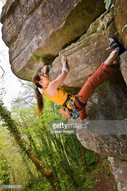 female climber on a difficult climb in the wye valley in south wales - extra long stock pictures, royalty-free photos & images