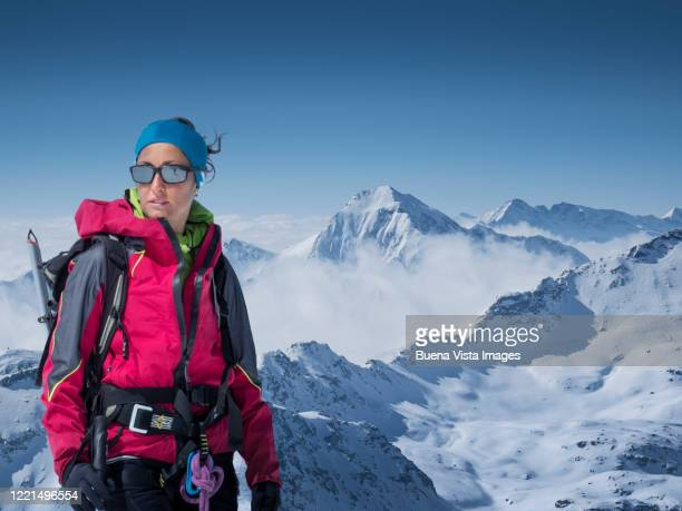 female climber on a mountain top - hot pink stock pictures, royalty-free photos & images