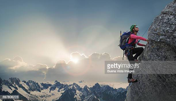 female climber on a rocky wall - mountaineering stock pictures, royalty-free photos & images