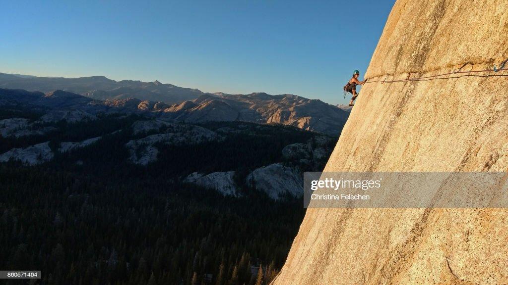 Female climber on the Lamb Dome traverse in Tuolumne, Yosemite National Park : Stock Photo