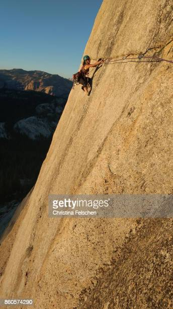 female climber on the lamb dome traverse in tuolumne, yosemite national park - christina felschen stock photos and pictures