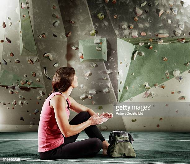 Female climber preparing hands with chalk
