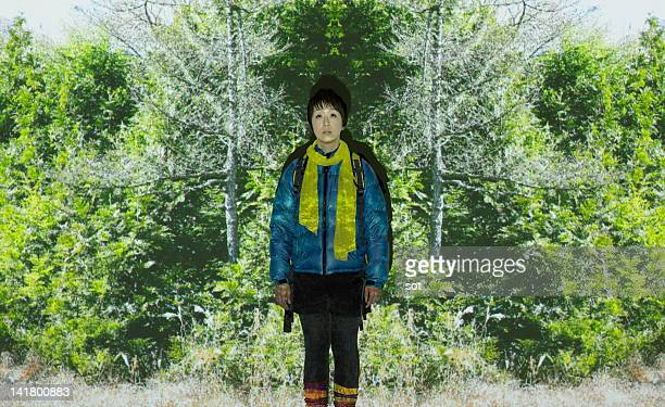 female climber standing in front of forest - projection equipment stock pictures, royalty-free photos & images
