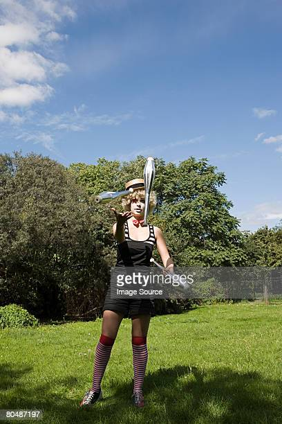 Female clown juggling