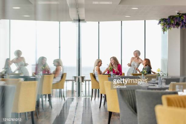 female colleagues having drinks together in bar - 30 34 years stock pictures, royalty-free photos & images