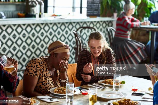 female colleagues laughing during business lunch - lunch stock pictures, royalty-free photos & images
