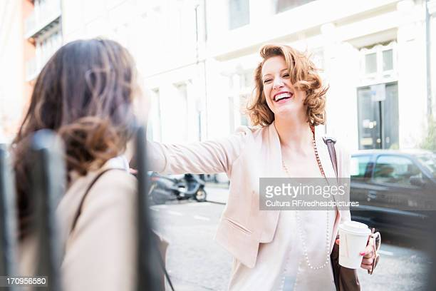 Female colleagues outside laughing