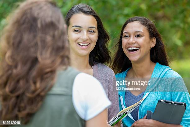 Female college friends laughing together outside