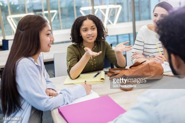 female college student gestures while talking with study group - debate stock pictures, royalty-free photos & images