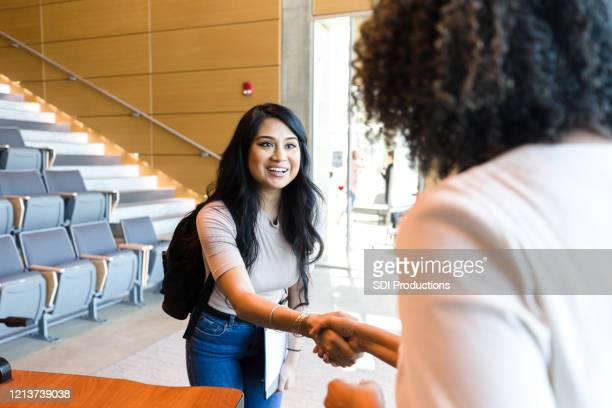 female college student greets professor - first day of school stock pictures, royalty-free photos & images