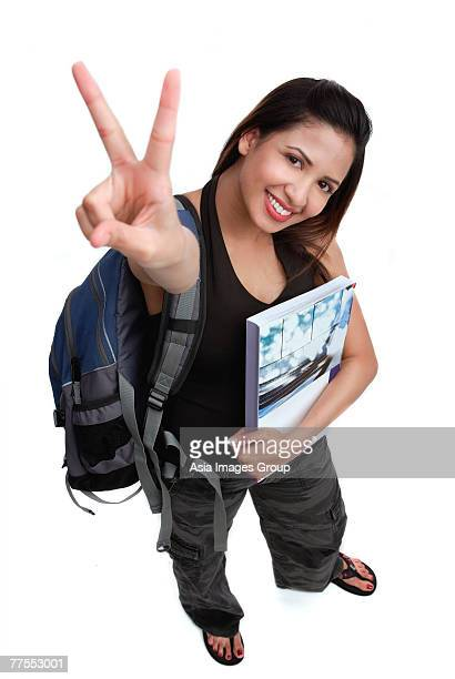 Female college student, high angle view, making hand sign