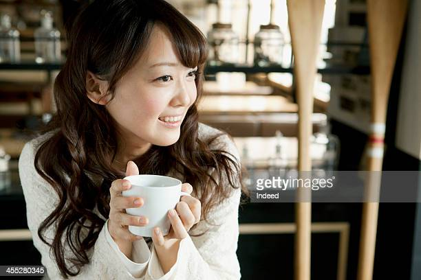Female college student relaxes in a cafe