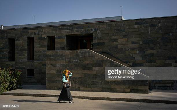 Female college student walks past a campus entrance August 31, 2015 at the Afghanistan Center at Kabul University in Kabul, Afghanistan.