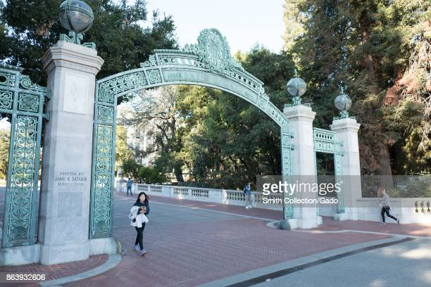A female college student walks through Sather Gate on the campus of UC Berkeley Berkeley California October 6 2017