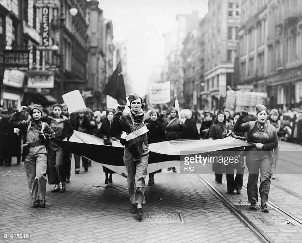 Female Communists show their support for the Spanish Loyalists against the forces of Fascist Germany during the Spanish Civil War by marching in...