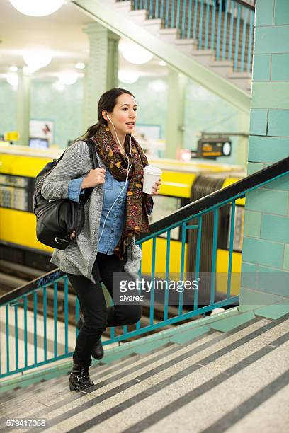 Female commuter exiting subway station