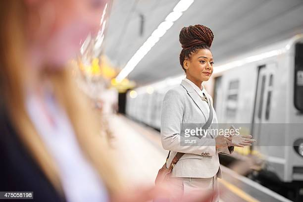 female commuter in the subway - black purse stock photos and pictures