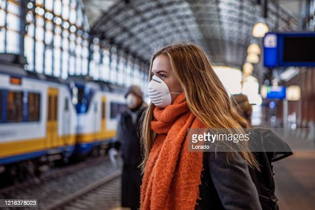 female commuter using public transport during virus outbreak - netherlands stock pictures, royalty-free photos & images
